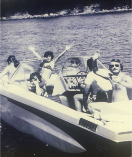 Grand times on my Dad's boat - I'm the kid with my arms in the air